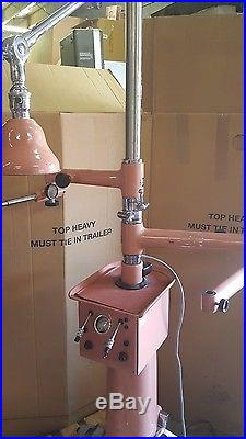 Vintage pink Stand with Lamp and vintage gage optometry stand American optical